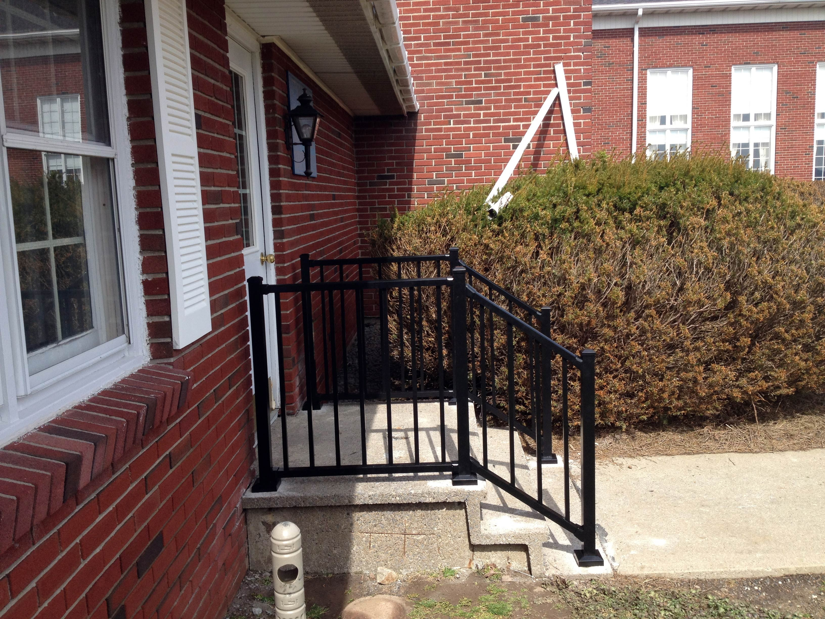 Picture of: Black Aluminum Front Porch Railing Red Brick House Randolph Indoor And Outdoor Design