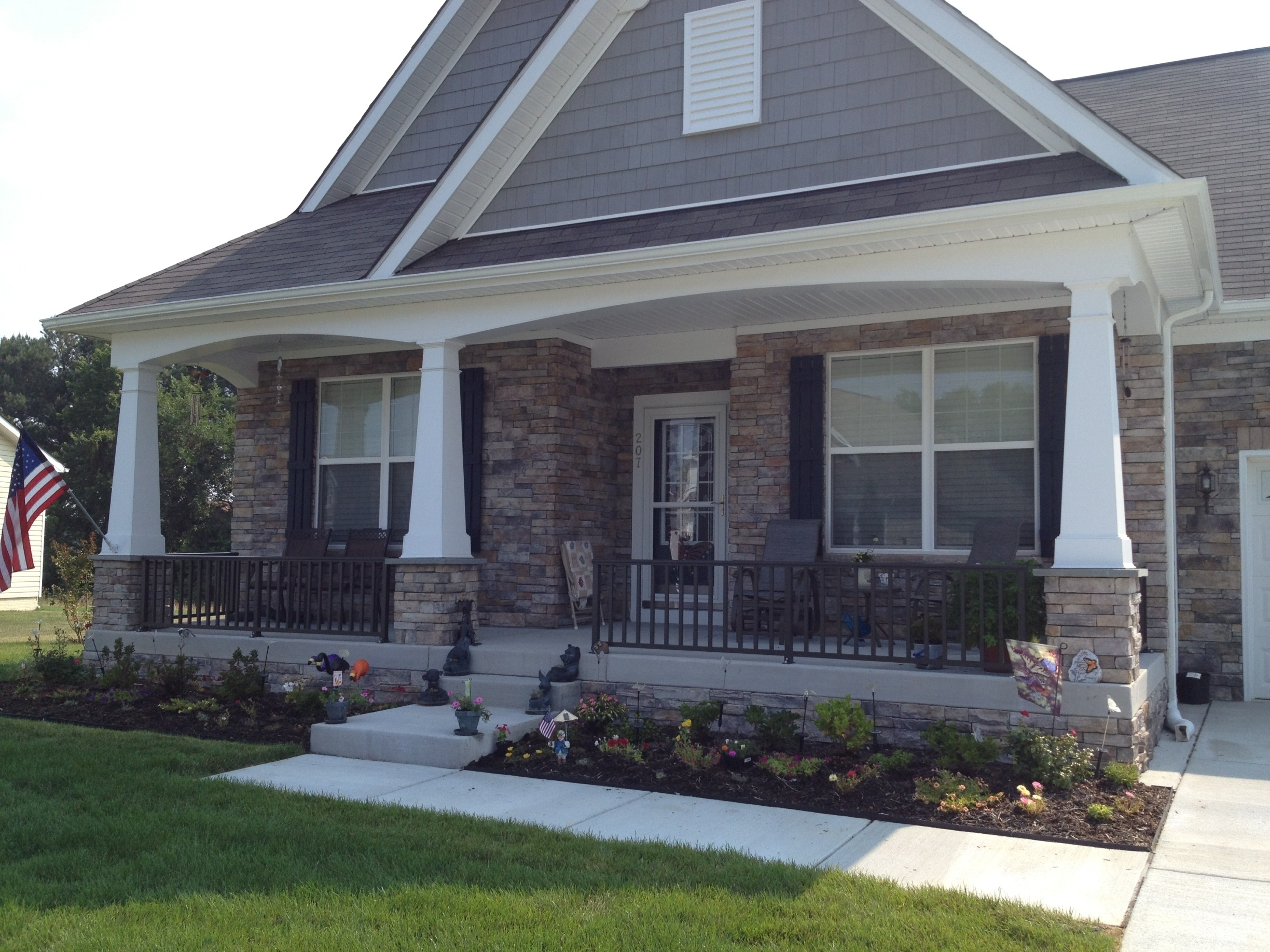 Porch With White Columns With Black Railing Randolph Indoor And Outdoor Design