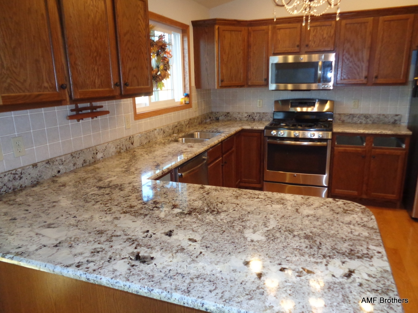 Alaskan White Granite With Tile Backsplash