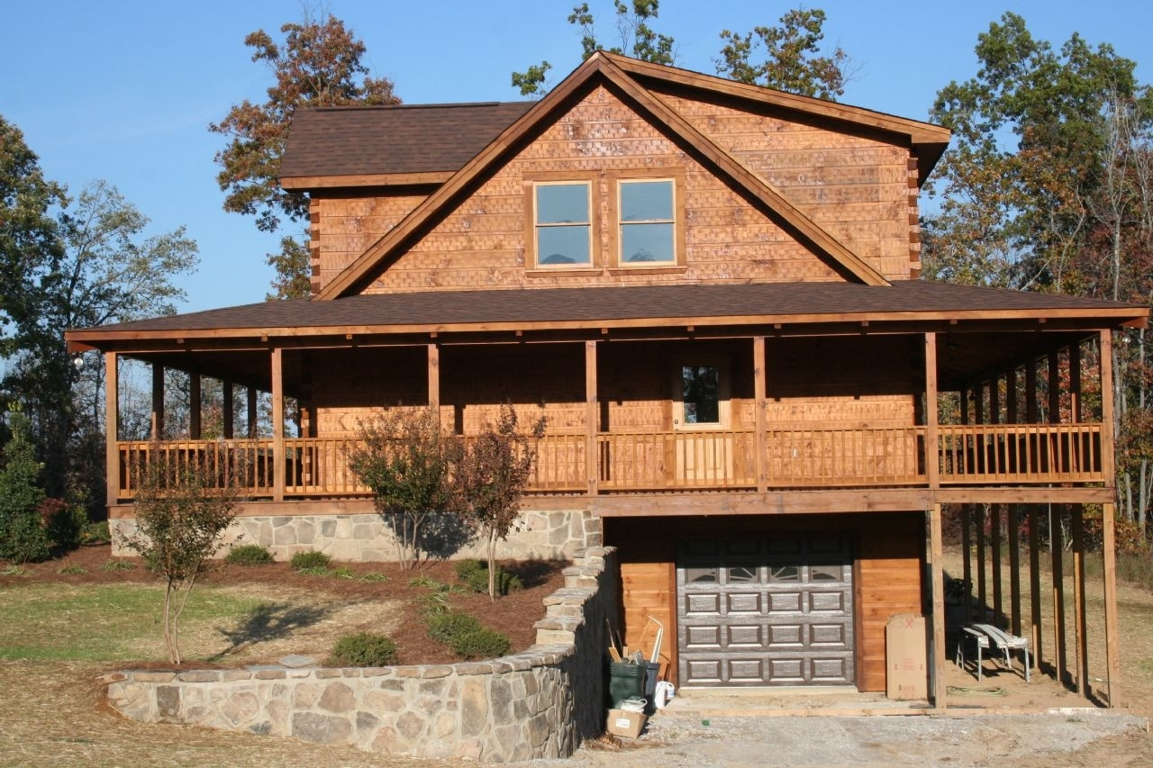 Raised Log Cabin With Wrap Around Porch — Randolph Indoor ... on large log home, natural log home, treated log home, painted log home, flat log home, single log home, smooth log home, restored log home, small log home, standard log home, square log home, solid log home, plain log home,